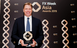 Nigel Fuller accepts Refinitiv's awards at the FX Week Asia Awards ceremony in Singapore